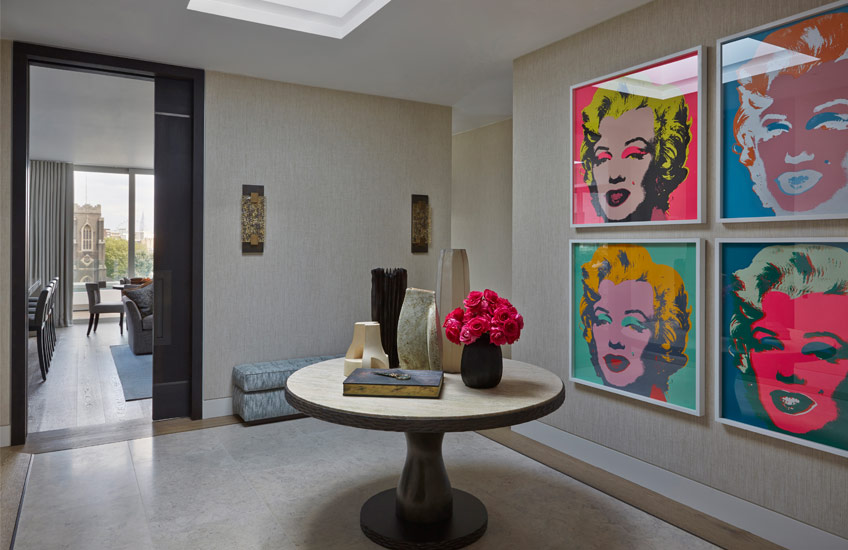 How To Style Your Round Entryway Table – Helen Green, London Interior Designer – Round Entryway Table, Andy Warhol prints – LuxDeco.com Style Guide