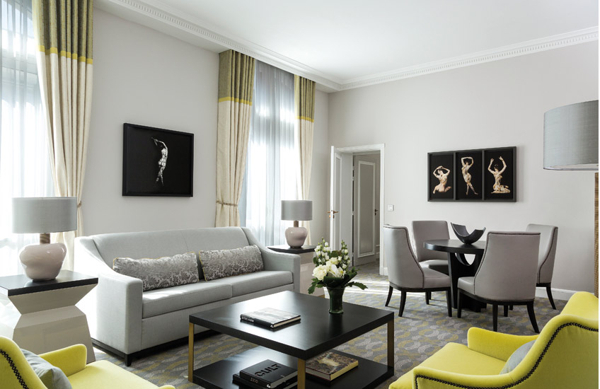 Lime Green and Light Grey Living Room | 15 Grey Living Room Ideas | Grey Lounge Colour Schemes | The Hilton Opera Paris Interiors | Read more in the LuxDeco Style Guide